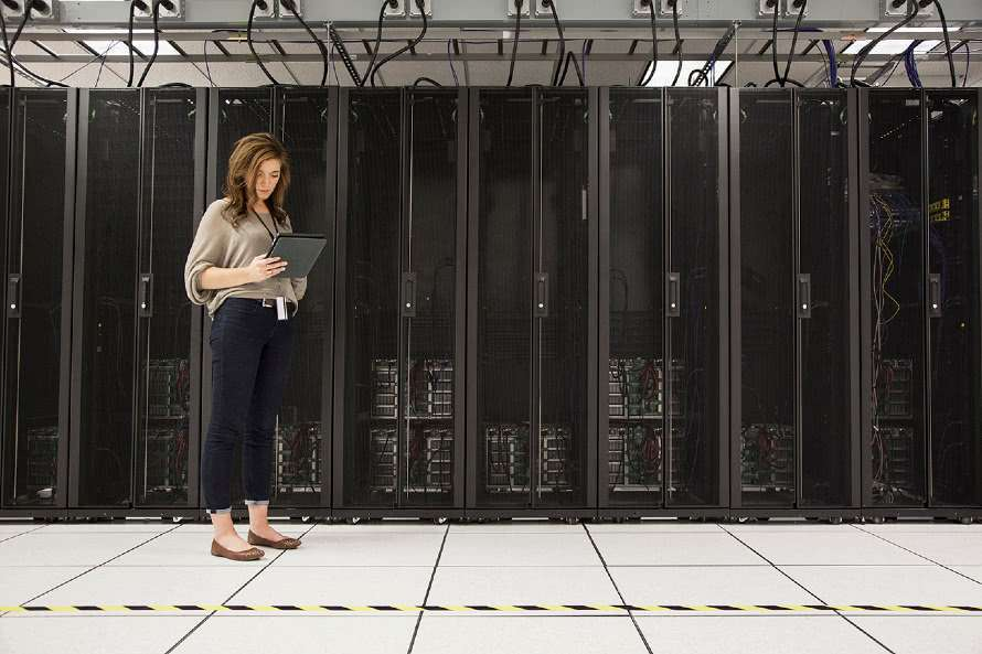 woman with ipad, server racks, data privacy, data protection